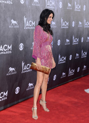 Angie Harmon looked foxy on the ACM Awards red carpet in a beaded purple mini dress by Roberto Cavalli.