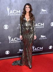 Kelleigh Bannen shimmered in a floor-sweeping silver and black sequined gown by Michael Costello during the ACM Awards.