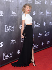 Taylor Swift added more elegance with a black M2Malletier clutch.
