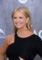 Nancy O'Dell wore a sleek and sophisticated center-parted hairstyle during the ACM Awards.