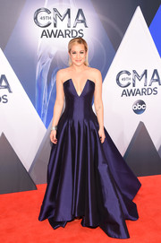 Kellie Pickler was an absolute stunner at the CMA Awards in a strapless jewel-toned gown by Rubin Singer, featuring a cleavage-baring plunge and a flattering fit-and-flare silhouette.