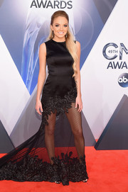 Danielle Bradbery put her fabulous pins on display in a sheer-bottom black gown during the CMA Awards.