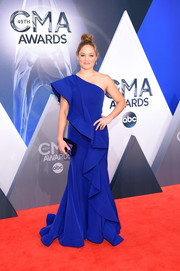Erika Christensen made an appearance at the CMA Awards wearing a mega-ruffled cobalt one shoulder gown by Gauri & Nainika.