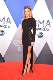 Kimberly Perry was modern and edgy at the CMA Awards in an asymmetrical black gown with a thigh-high slit and grommet detailing.