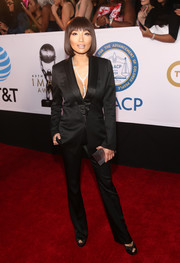 Jeannie Mai kept it sleek and sophisticated in a black satin pantsuit by Styland at the 2018 NAACP Image Awards.
