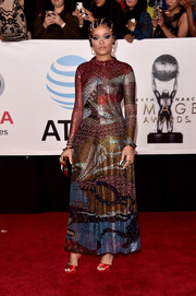 Andra Day looked vibrant and glam in a graphic beaded gown by Armani at the 2018 NAACP Image Awards.