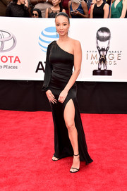Draya Michele looked simply divine in a black one-sleeve gown with a high side slit at the 2018 NAACP Image Awards.