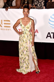 Betty Gabriel went for a summery vibe in a floral gown with waist cutouts at the 2018 NAACP Image Awards.