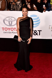 Tamera Mowry-Housley looked exquisite in a sheer-panel black one-shoulder gown by Michael Costello at the 2018 NAACP Image Awards.