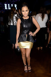 Adrienne Bailon chose a leather peplum top to add some edge to her evening look at Elle's Women in Music Celebration.
