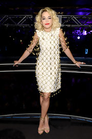 Rita Ora showed off her funky style with this white frock that featured gold mesh overlay.
