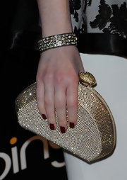 Michelle Trachtenberg wore a gemstone adorned bangle to the Hollywood Domino Gala.