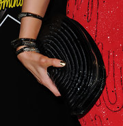 Paris Hilton wore an arm full of sparkling bangle bracelets with pavé gemstones.