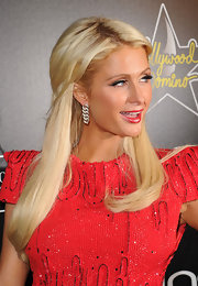 Paris Hilton is all about the glitz and glamour. The heiress wore dangling diamond earrings to the Hollywood Domino Gala.