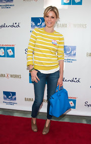 Julie Bowen opted for a bright yellow sweater with white stripes for her red carpet look at Milk + Bookies Story Time.