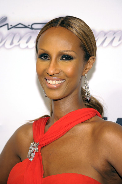 Iman's caramel locks looked sleek and smooth with a low, wavy ponytail.