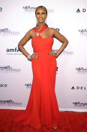 Iman showed off her long and lean figure with  this flowing red halter dress.
