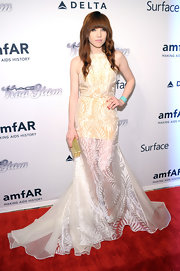 Carly Rae looked simply ethereal with a sheer white gown paired over a sunny yellow dress.
