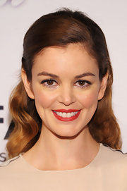 Nora Zehetner pulled back her strawberry brown waves into a lovely half updo.