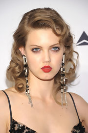 Lindsey Wixson was a vision of retro chic with a tight curled 'do.