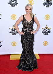 Jamie Lynn Spears channeled her inner mermaid princess in a curve-hugging black gown with a scalloped skirt and an embroidered sheer bodice during the Academy of Country Music Awards.