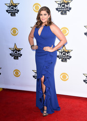 Hillary Scott dressed up her curves in a blue ruffle gown by Badgley Mischka for the Academy of Country Music Awards.