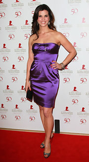 Lu Parker topped off her purple satin frock with sparkly peep-toe pumps.