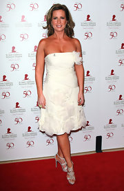 Martha Byrne accessorized her white frock with floral embellished strappy sandals.