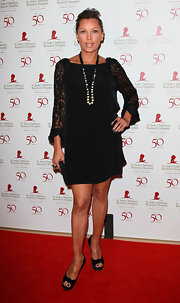 Vanessa Williams opted for a simple black dress with lace accents at the St. Jude soiree in Beverly Hills. The ageless beauty topped off her look with black peep-toe pumps.