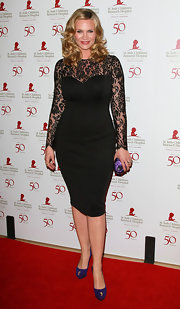 Natasha Henstridge added a pop of color to her lacy black dress with deep purple platform pumps.
