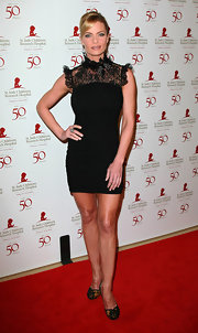 Jaime Pressly accessorized her black mini dress with matching embellished black pumps.