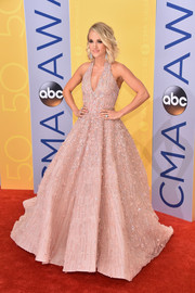 Carrie Underwood looked absolutely breathtaking in this beaded pink ball gown by Michael Cinco at the CMA Awards.