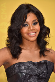 Gabrielle Douglas wore her hair just past her shoulders in a glamorous curly style during the CMA Awards.