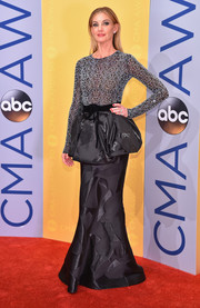 Faith Hill made a head-turning entrance in an Armani Privé gown, featuring a beaded bodice and exaggerated peplum detailing, at the CMA Awards.