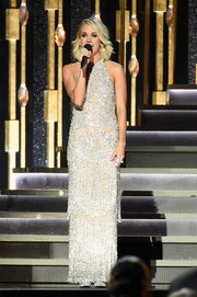 Carrie Underwood looked resplendent in a heavily embellished silver gown by Jovani at the CMA Awards.