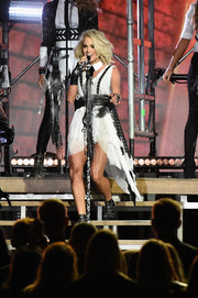 Carrie Underwood performed at the CMA Awards looking edgy in a distressed white Marina Toybina mini dress with grommeted harness detailing.