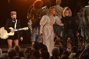 Beyonce Knowles looked every inch the queen in this beaded, puff-sleeve gown while performing at the CMA Awards.