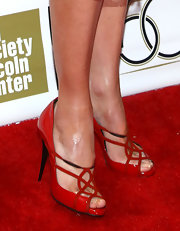Nicole Kidman finished off her flaming frock with these strappy fire engine red peep-toe pumps.