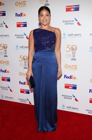 Gina Rodriguez went for modern glamour in an asymmetrical blue gown with a sequined bodice at the NAACP Image Awards Non-Televised Dinner.