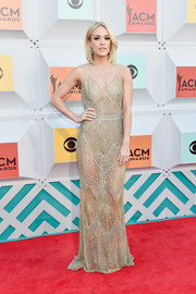 Carrie Underwood was sultry and sophisticated in a beaded, sheer gold gown by Davidson Zanine at the Academy of Country Music Awards.