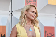 Miranda Lambert's Irene Neuwirth opal pendant made a lovely color contrast to her yellow gown.