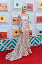Savannah Chrisley showed lots of skin in a sheer, embroidered fishtail gown by Amato Couture at the 2016 ACM Awards.