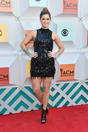 Cassadee Pope complemented her dress with black peep-toe ankle boots.