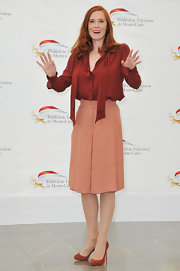 Audrey Fleurot finished off her outfit with simple suede Christian Louboutin pumps that matched the color of her blouse.