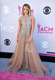Carrie Underwood was a standout in a bedazzled nude gown by Labourjoisie at the 2017 ACM Awards.