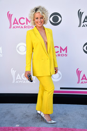 Cam was impossible to miss in her cleavage-baring canary-yellow Topshop suit at the 2017 ACM Awards.