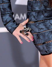 Miley shows off this cool looking ring that she paired with her futuristic dress. The pop star always adds intersting jewelery to her outfit.