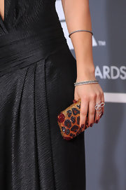 Kaley paired this dazzaling leopard print box clutch with her black gown. Nice added accessory.