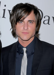 Jared's hair screams rocker with the variety of layers, longer length and in his face bangs.