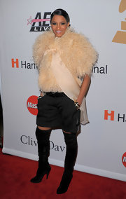 Ciara made a furry appearance in this beige overcoat ,which she paired with suede over-the-knee boots. They probably weren't the best shoes to match with her black shorts, but we'll forgive her.